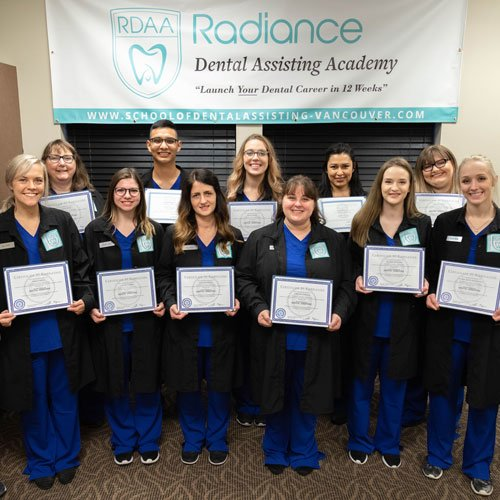 dental assistant students posing for a photo with their instructor